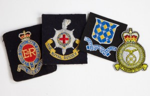 cap badges, blazer badges, cufflinks and tie clips
